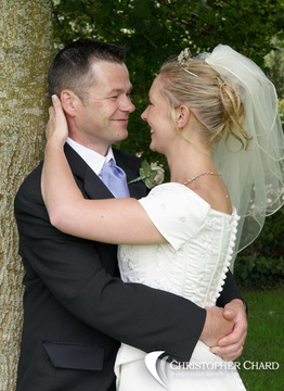 Bride and Groom in love next to a tree